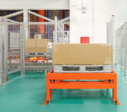Box at Pallet. Pallet With Box at Automated Storage and Retrieval System in Warehouse Stock Image