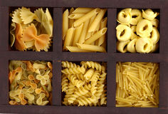 Box with pasta. Box of wood with raw pasta Stock Photography