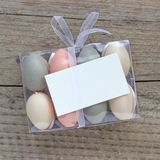 Pastel-colored Easter eggs. Box of pastel-colored Easter eggs and copy space Stock Photos