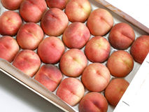 Box of peaches. Box of yellow peaches stock photo