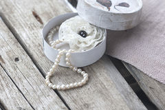 Box with pearl necklace and brooch Stock Images