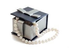 Box with pearls. A string of pearls in a box on white background Stock Photo