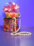 Box with pearls on violet Royalty Free Stock Image