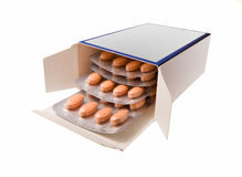 Box with pills isolated on white. Open box with pile of blisters Royalty Free Stock Image