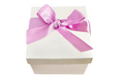 A box with a pink ribbon on a white background. A box with a pink ribbon isolated on a white background Royalty Free Stock Photo