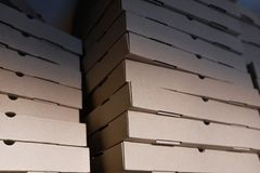 Box for pizza delivery empty closed brown cardboard paper Sartana. Food delivery. Pizza delivery royalty free stock photography
