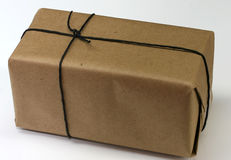 Box with plain brown wrapping paper stock photography