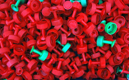 Box of Plastic objects background. Red and green plastic objects piled into a box Stock Photography