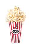 Box of Popcorn. Red and white striped box overflowing with popcorn. Isolated against a white background stock images