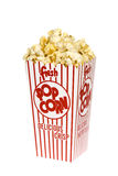 Box of popcorn. A container of movie popcorn isolated on a white background for use with any casual inference stock images