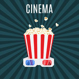 Box of popcorn and 3d cinema glasses Royalty Free Stock Image
