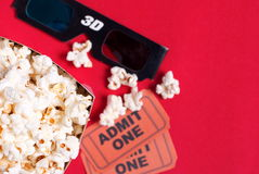 Box of popcorn, glasses and tickets. Box of popcorn, glasses and ticket Stock Images