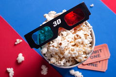 Box of popcorn, glasses and tickets Royalty Free Stock Image