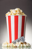 Box of popcorn and movie ticket on a gray Stock Photography