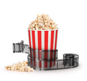Box of popcorn with a strip of 35mm film. On a white background, symbols of the entertainment industry, 3d illustration Stock Photos