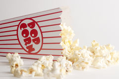 Box of popcorn toppled over. A box of popcorn on its side stock photography
