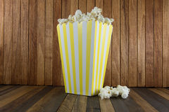 A box of popcorn on wooden background stock photo