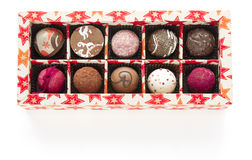 Box of pralines on white background Royalty Free Stock Images