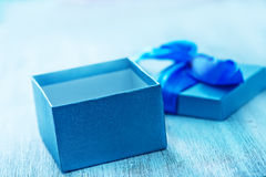 Box for present. Blue box for present on the wooden table stock images