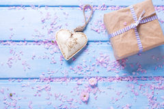 Box with present and decorative  heart on blue wooden planks. Stock Photography