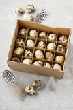 Box of quail eggs. Easter decoration stock photos