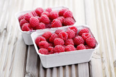 Box of raspberries Stock Photos