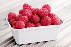 Box of raspberries stock photos