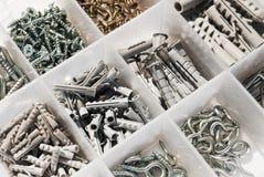 Box with Rawlplug  and screws. Plastic box with Rawlplug  and screws Stock Photos