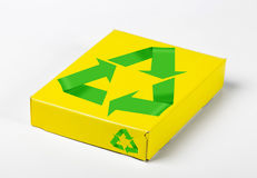 Box with recycle symbols. Yellow box on white with recycle symbols Stock Photos