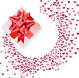 Box with red bow and confetti hearts on white Royalty Free Stock Photo