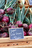 Box of Red Onions Stock Photos