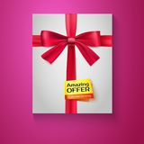 Box, red ribbon, bow and the badge Amazing offer. Box tied red ribbon with the bow and the badge Amazing offer, on colored background Stock Photo