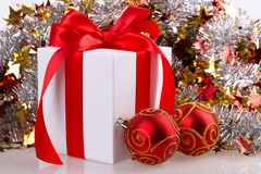 Box red ribbon bow silver tinsel Stock Images