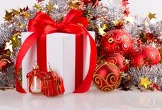 Box red ribbon bow silver tinsel Royalty Free Stock Images