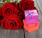 Box and red roses Stock Photos