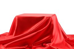 Box in red silk fabric background. Stock Photos