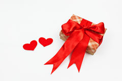 Box with ribbon and hearts on white background Royalty Free Stock Photos