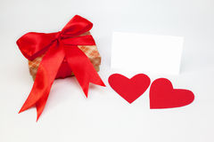 Box with ribbon, hearts and white on white background Stock Image