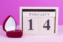 Box with ring and wooden calendar. Valentine`s Day Gift. Proposal for the beloved royalty free stock images