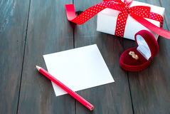Box for rings and heart gift Royalty Free Stock Photography