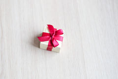 Box for rings with a red ribbon on the table Stock Photo
