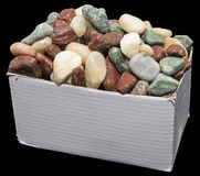 Box of rocks isolated black Stock Photography