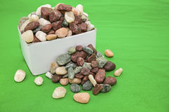 Box of rocks loose green background Stock Photography