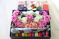Box with roses and cakes macaroon. Gift box with roses and cakes macaroon royalty free stock photos