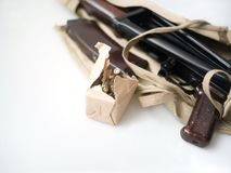 Pack of rounds and gun machine. A box of rounds and a gun machine wrapped in material, shallow depth of field studio shot stock images