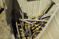 Box of Rusty Nails. Always working on our homestead.  A box of rusty nails waiting to be put to use Stock Photos