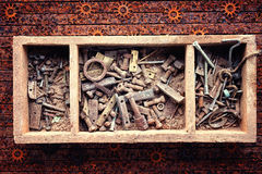 Box with rusty screws, bolts and nuts Royalty Free Stock Photography