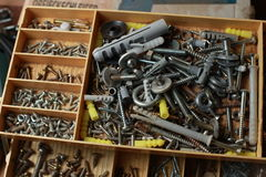 Box with screws and dowels Stock Photo
