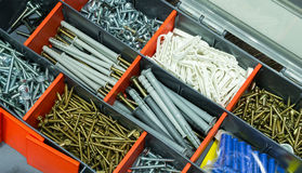 A box with screws, dyupels, fasteners. Stock Photos