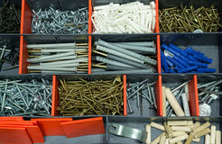A box with screws, dyupels, fasteners. Royalty Free Stock Images